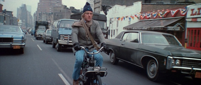 Evidently, James Bond traded in his Aston Martin for a motorbike.