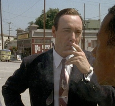 Kevin Spacey takes a drag from a Chesterfield as Jack Vincennes in L.A. Confidential (1997).