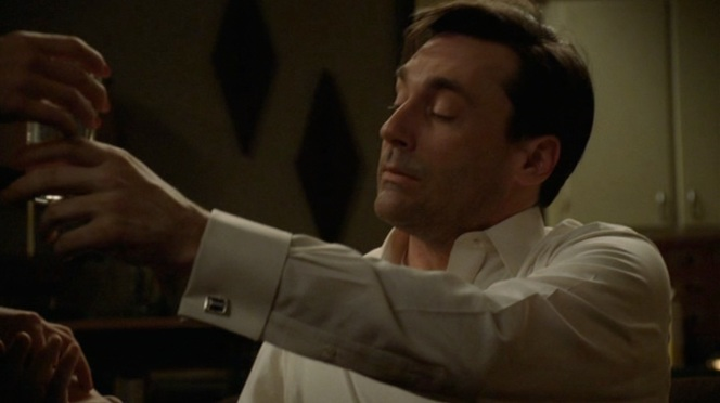 don cuff links as he reaches for aspirin