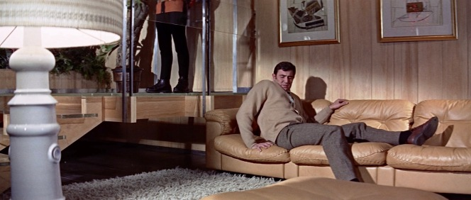 Much to his horror, Bond woke up laying down and the first person he saw was Telly Savalas in a tight turtleneck(!)