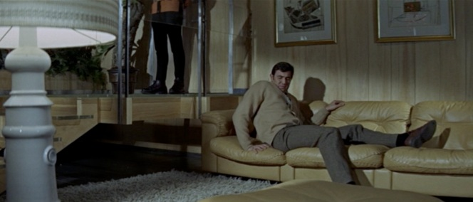 To his horror, Bond woke up laying down and the first person he saw was Telly Savalas. (!)