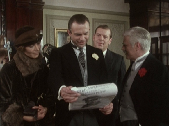The Trust presents Reilly with the poster condemning him to death if he ever steps foot on Russian soil. Simultaneously the coolest and the shittiest wedding gift ever.