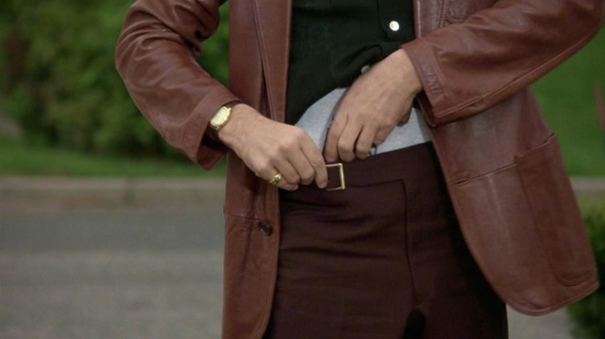 A great shot of the watch, ring, gun, shirt, pants, jacket, etc. Don't get Freudian on me.