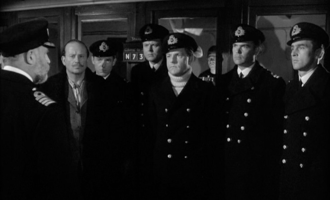 Lightoller and fellow officers are addressed by Captain Smith in various manners of dress. After Ismay, who shows up in his pajamas, 3rd Officer Pitman, 4th Officer Boxhall, 2nd Officer Lightoller, 1st Officer Murdoch, and 5th Officer Lowe. Of those pictured, only Murdoch doesn't survive. Unseen are 6th Officer Moody and Chief Officer Wilde. Neither of them survived.