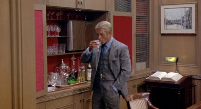 Many guys prefer to store beer in their bar fridge, but Steve McQueen takes it up a notch and has a fully-prepared dry martini waiting for him.