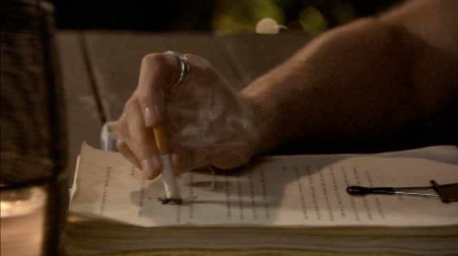 If Hank was so worried about losing his manuscript, why does he use it to extinguish his cigarette?