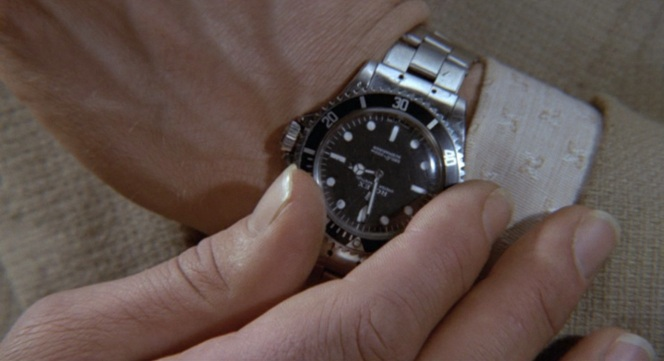 Wait, what kind of watch is wearing? I don't think the movie made it COMPLETELY OBVIOUS enough.
