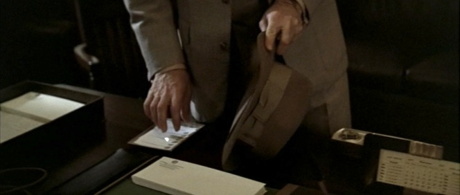Gittes rips off a stack of Yelburton's business cards. Why? We're not sure yet. Honestly, neither is he.