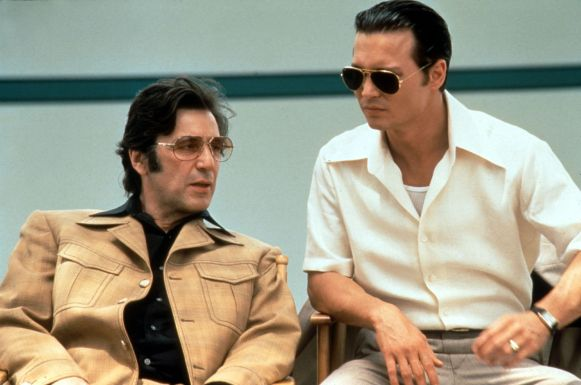 Pacino looks every bit of 1979 in his leisure suit and tinted glasses. Depp, on the other hand, could easily slip into a party today... if only that shirt wasn't quite so big.