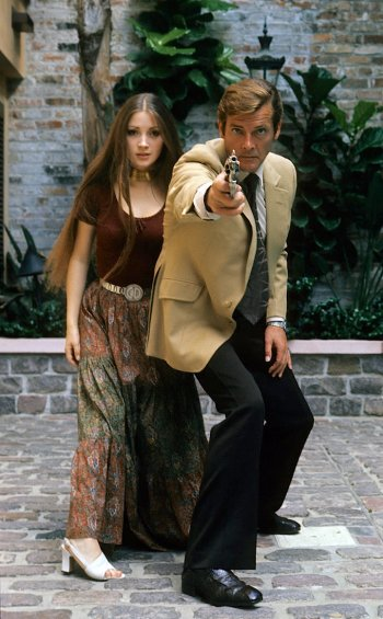 Jane Seymour and Roger Moore on location for Live and Let Die in Kingston, Jamaica, 1973. Photo by Anwar Hussein.