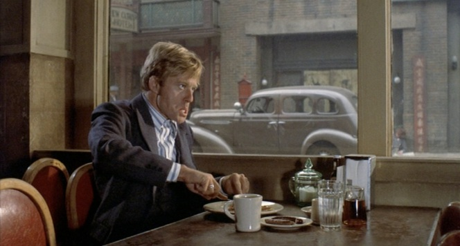 Evidently, that morning's blue plate special wasn't sitting too well with Redford.