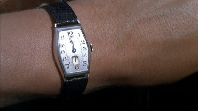 Redfern's watch, as seen in an earlier scene. Any eagle-eyed fans out there able to identify it?