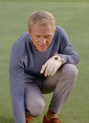 Steve McQueen as Thomas Crown, lining up the perfect shot on the links in The Thomas Crown Affair.