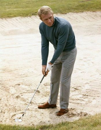 Steve McQueen as Thomas Crown, lining up the perfect shot on the links in 1968's The Thomas Crown Affair.