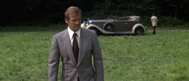 Bond poses near his ride of choice.