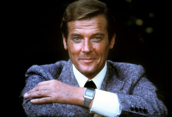 Moore poses with his watch and his eyebrows.