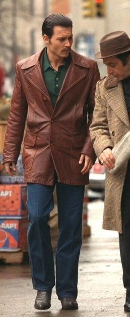 Johnny Depp as Joe Pistone, aka Donnie Brasco, with his clothing undergoing Al Pacino's scrutiny in Donnie Brasco.