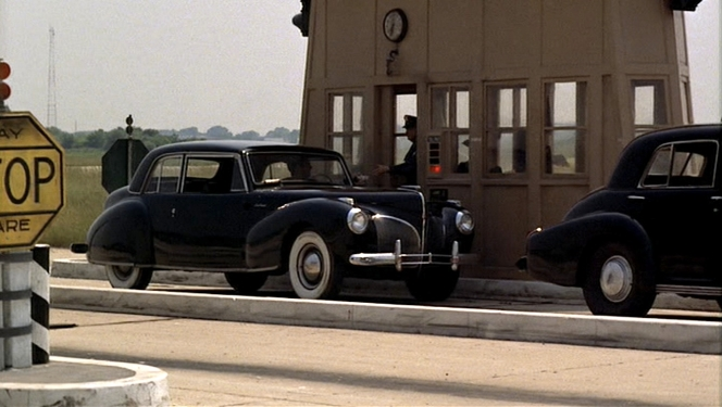 Sonny's beautiful Lincoln, pulling up to the tollbooth...