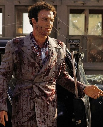 "James Caan being fitted for his death suit as ""Sonny"" Corleone in The Godfather."