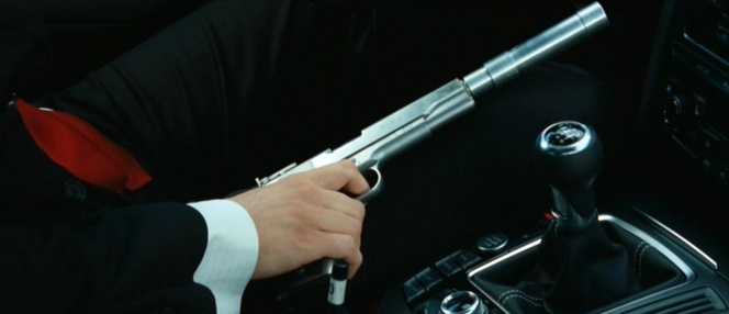 Like any good movie hitman, Agent 47 uses a suppressor on his pistol.