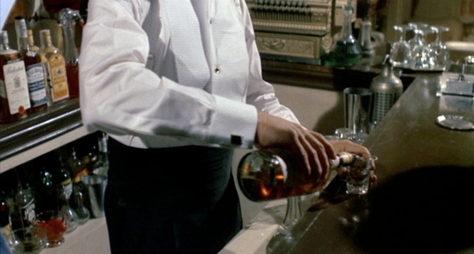Gondorff pours a shot from The Man's Bar.