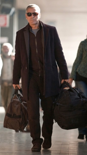 George Clooney as Jack in The American (2010), showing us what men should look like when traveling.