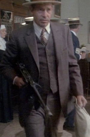 A very Dillinger-esque Warren Oates as John Dillinger, leaving a South Bend bank job in 1973's Dillinger.