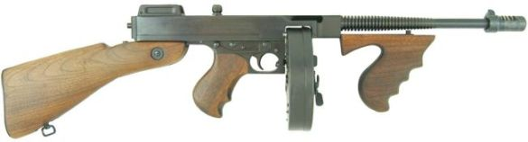 A Thompson submachine gun, Model 1928. This has the Cutts compensator, the vertical handgrip, and the drum magazine that all became part of the popular gangster/Tommy gun association. The full stock was often removed by gangsters like Dillinger for easier mobility and concealment.