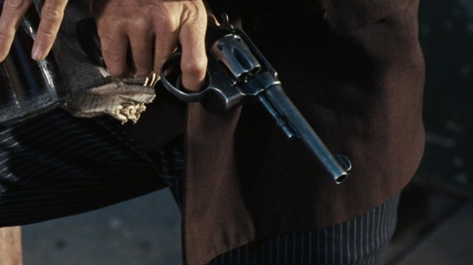 In this scene, the revolver represents a penis. You can't rely deny that once she starts stroking it :-/