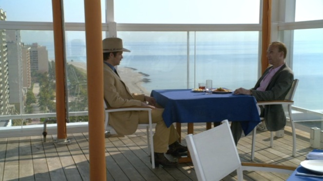 The other guy is dressed in more traditional Miami attire, but Raylan looks infinitely cooler.