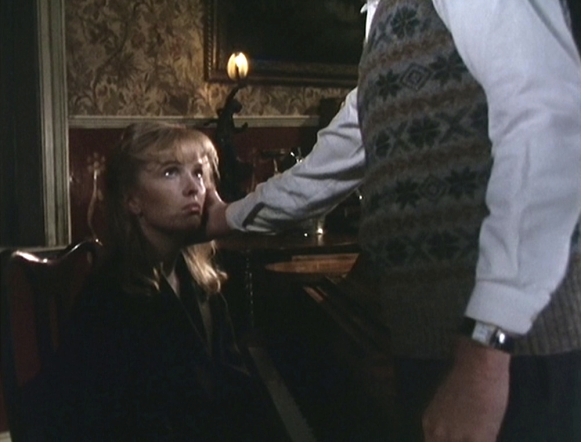 Reilly comforts Alexandra after she watched him just shoot a guy in the chest. Might take more than a pat on the chin...