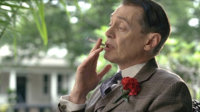 Nucky takes a drag from one of his Luckies while on the porch with Eli.