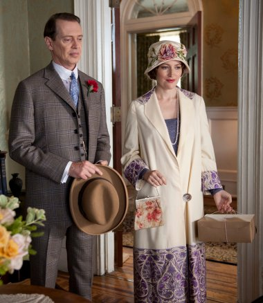 Nucky and Margaret conceal their hatred for each other with bright colors and fancy hats.