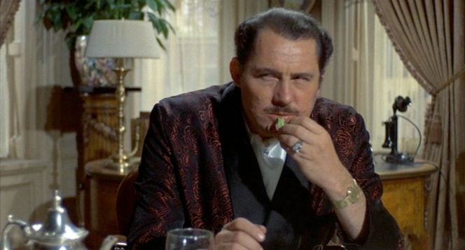 Think flowered robes, white silk scarves, and diamond jewelry is effeminate? Try telling Robert Shaw that.