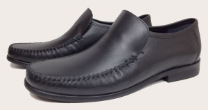 Bond preferred pair of black leather hand-stitched moccasins. This is Coogan's Finchley model, available for only £36 from Coogan London's online store.