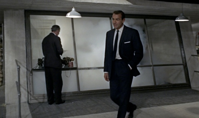 Bond struts into Q's lab.