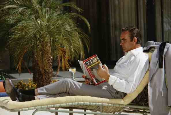 Bond kicks back by reading about... war crimes and massacre? The Playboy in On Her Majesty's Secret Service made a little more sense.