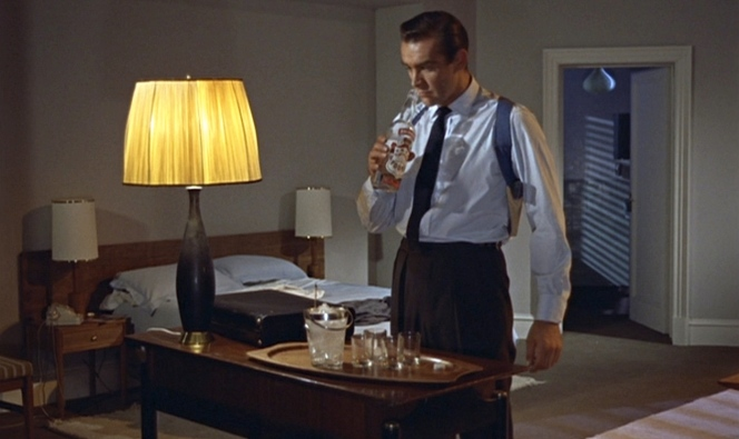 Cocktail hour for James Bond. Here, his shoulder holster is buttoned to the rear of the 3-button side adjusters.