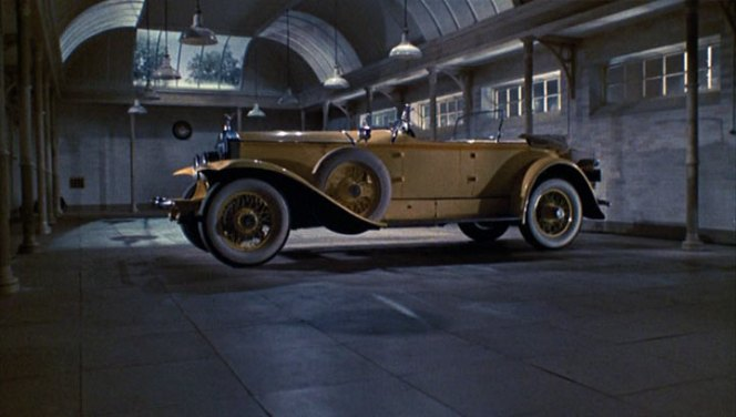 Gatsby's Rolls sits alone in his garage.