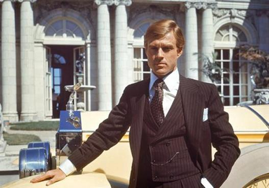 Robert Redford as Jay Gatsby in The Great Gatsby (1974), posing with his yellow 1928 Rolls-Royce Phantom I convertible.