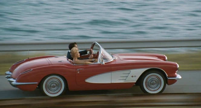 Kemp and Chenault speed towards the ocean in Hal's Corvette.