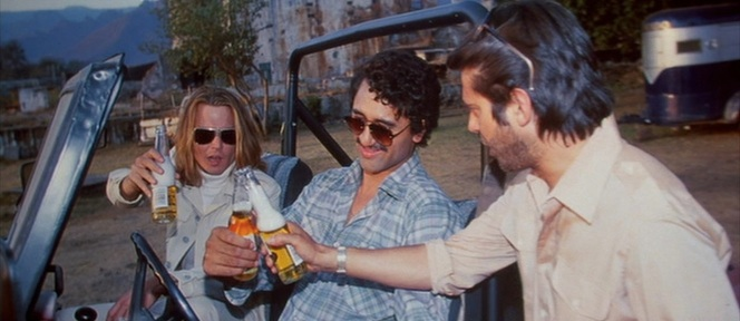 "If you pause during the hectic ""Blinded By the Light"" montage, you can see George and Diego cracking open some fresh Coronas with El Patrón."