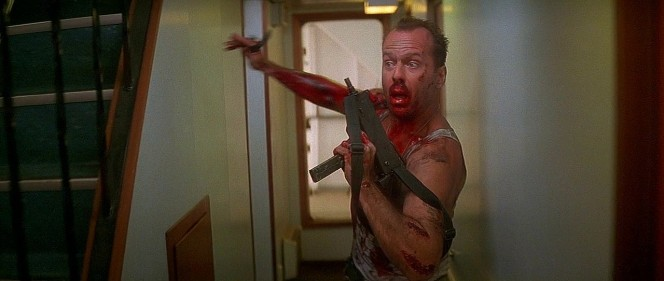 McClane arms himself with a terrorist's MAC-10.