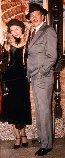 Warren Oates and Michelle Phillips as John Dillinger and Billie Frechette, respectively, in Dillinger (1973). The film inaccurately portrays Polly Hamilton as an alias for Billie Frechette; in reality, Polly was an entirely different person.