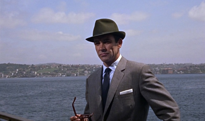 Don't be one of those douchebags who doesn't know how to wear a hat. Learn from James Bond.