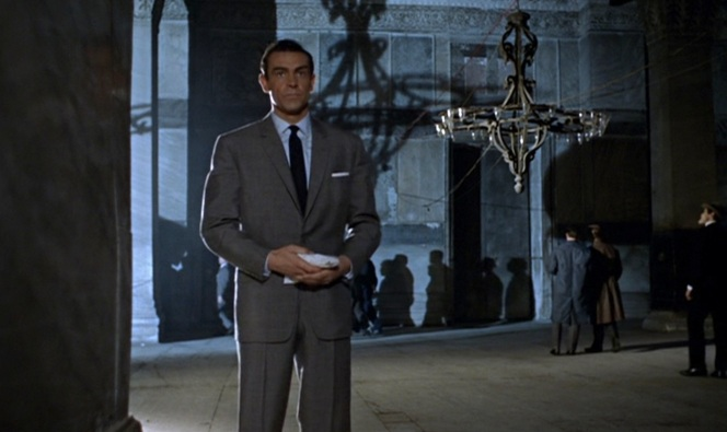Connery nailed the gray suit, light shirt, and blue tie look.