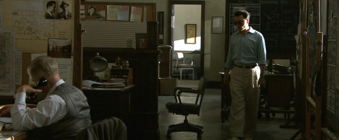 Dillinger nonchalantly steps into the office filled with men whose sole purpose in life is to capture and kill him.