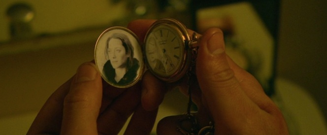 Public Enemies ignores Polly Hamilton in favor of the more romantic notion of placing Billie Frechette's photo inside Dillinger's watch.