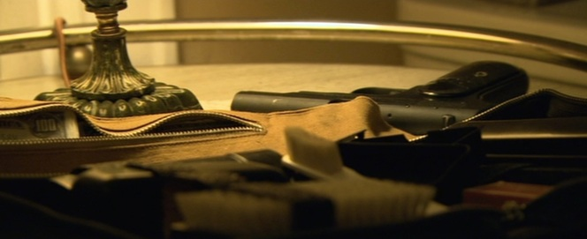 Dillinger's Colt pistol and money belt, moments before heading out to the Biograph.
