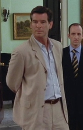 Pierce Brosnan as Andy Osnard in The Tailor of Panama (2001). His right arm is folded behind his back; he is not playing an amputee.